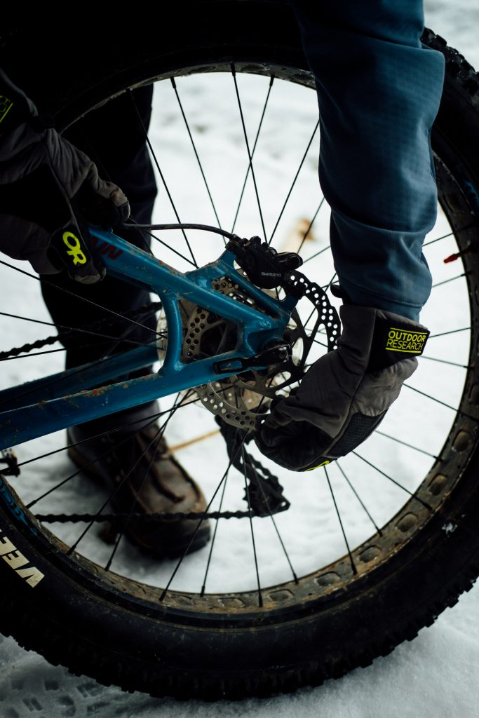 The rear tire and brakes on a fat bike