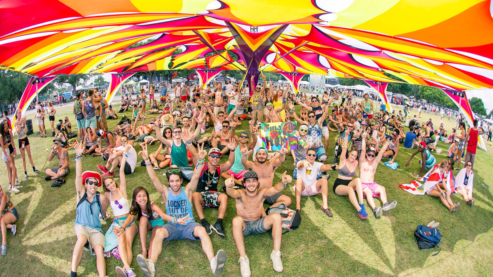 Shaded area with fans at Sunset Music Festival 2015