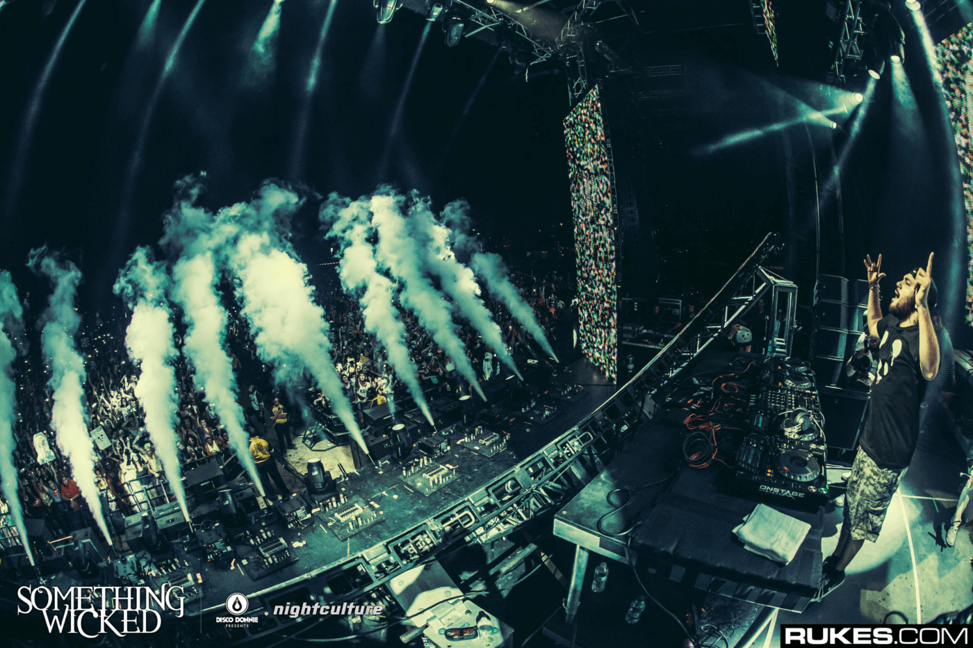 deorro stage in smoke at something wicked