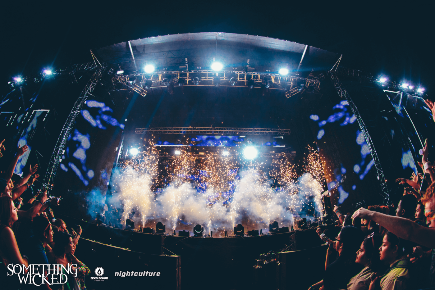 smoke and lights on stage at something wicked