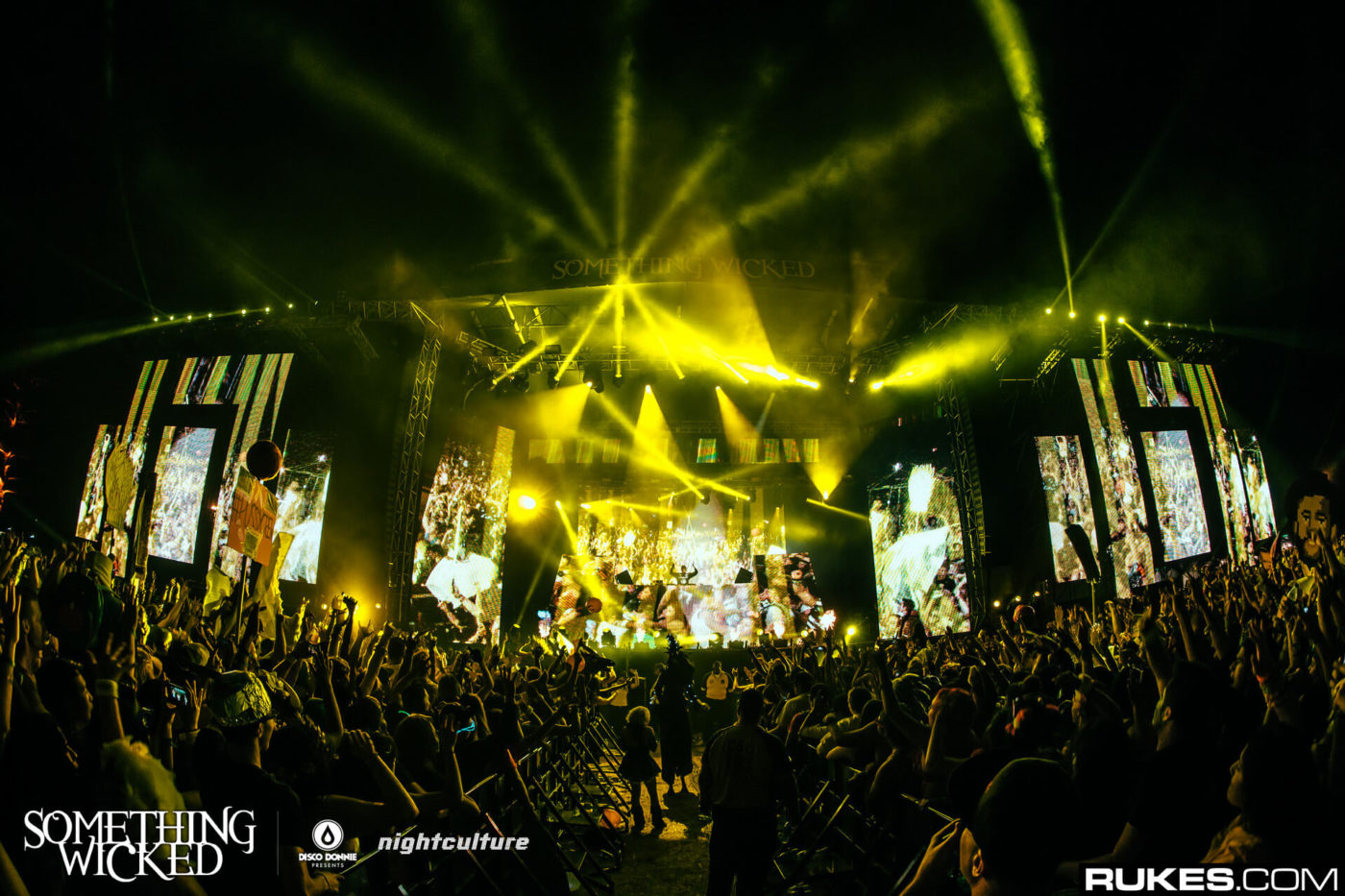 dillon francis stage lights and crowd at something wicked