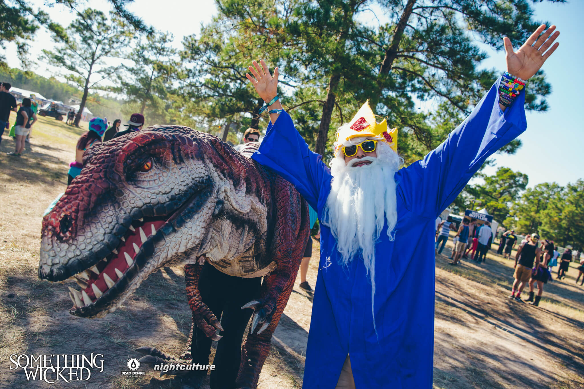 wizard and dinosaur in costume at something wicked