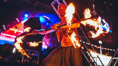 Costumed fire performer at Sun City Music Festival 2015