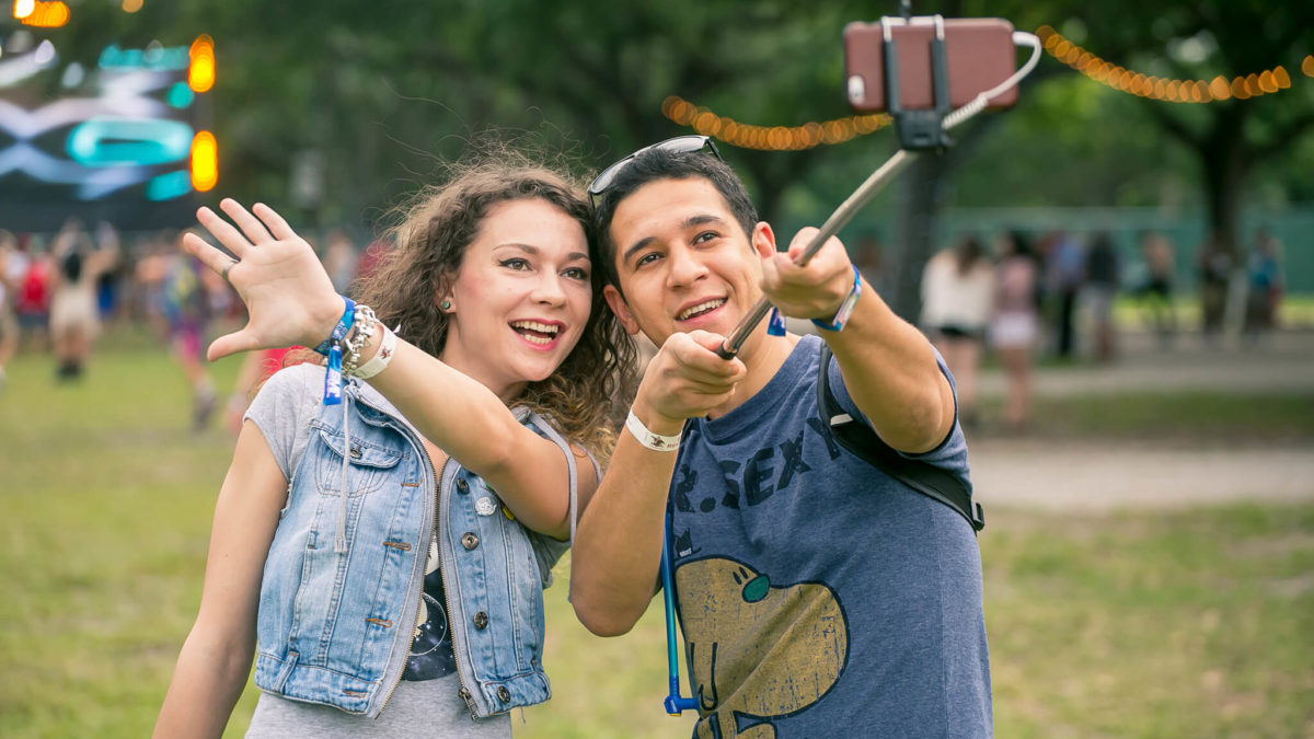 Fans with selfie stick at Sunset Music Festival 2015