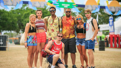 group of friends at sunset music festival