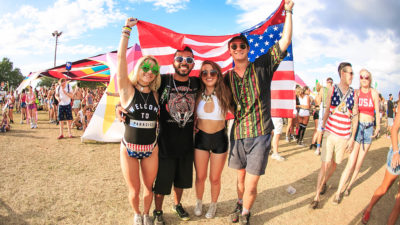 festive fans at sunset music festival on memorial day weekend