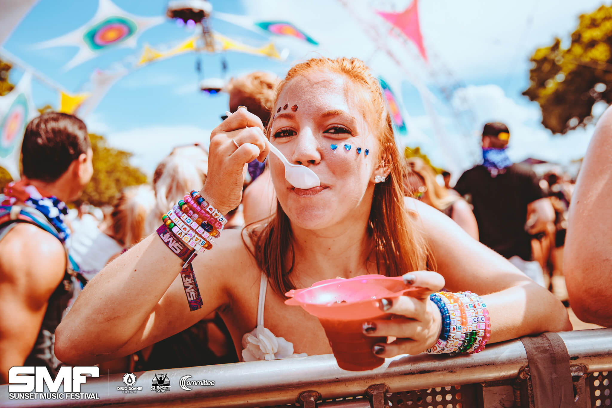 front row fan munching at sunset music festival
