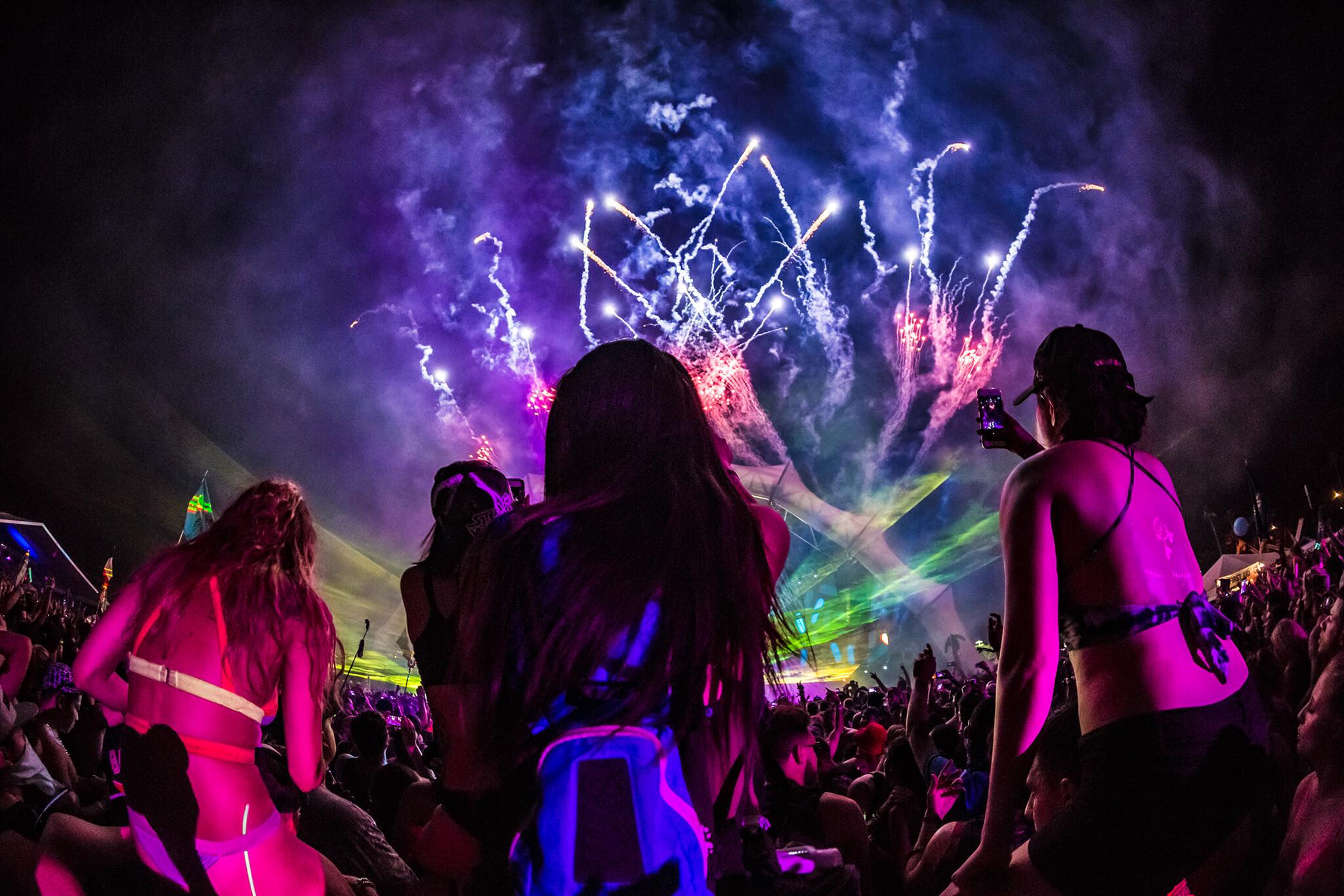 girls together at sunset fireworks finale