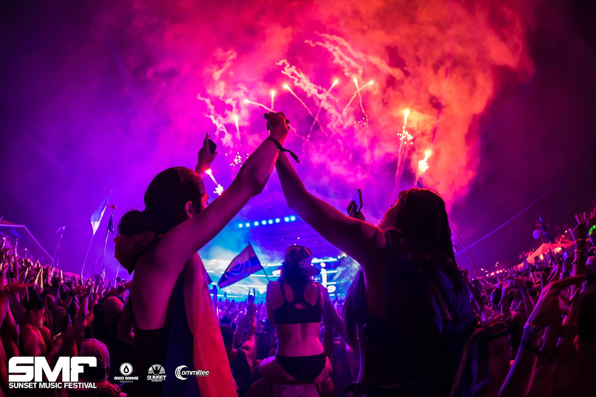 fans holding hands fireworks finale