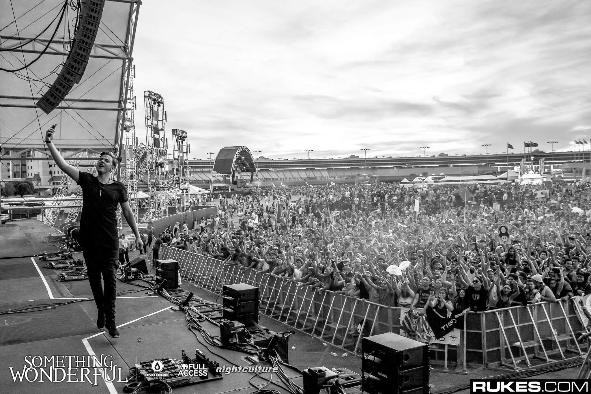sam feldt taking a selfie on stage at something wonderful festival