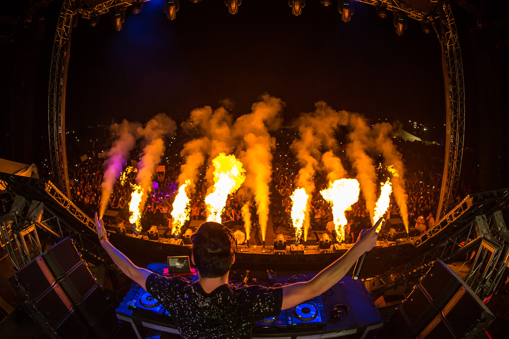 Martin Garrix performing on main stage with pyro