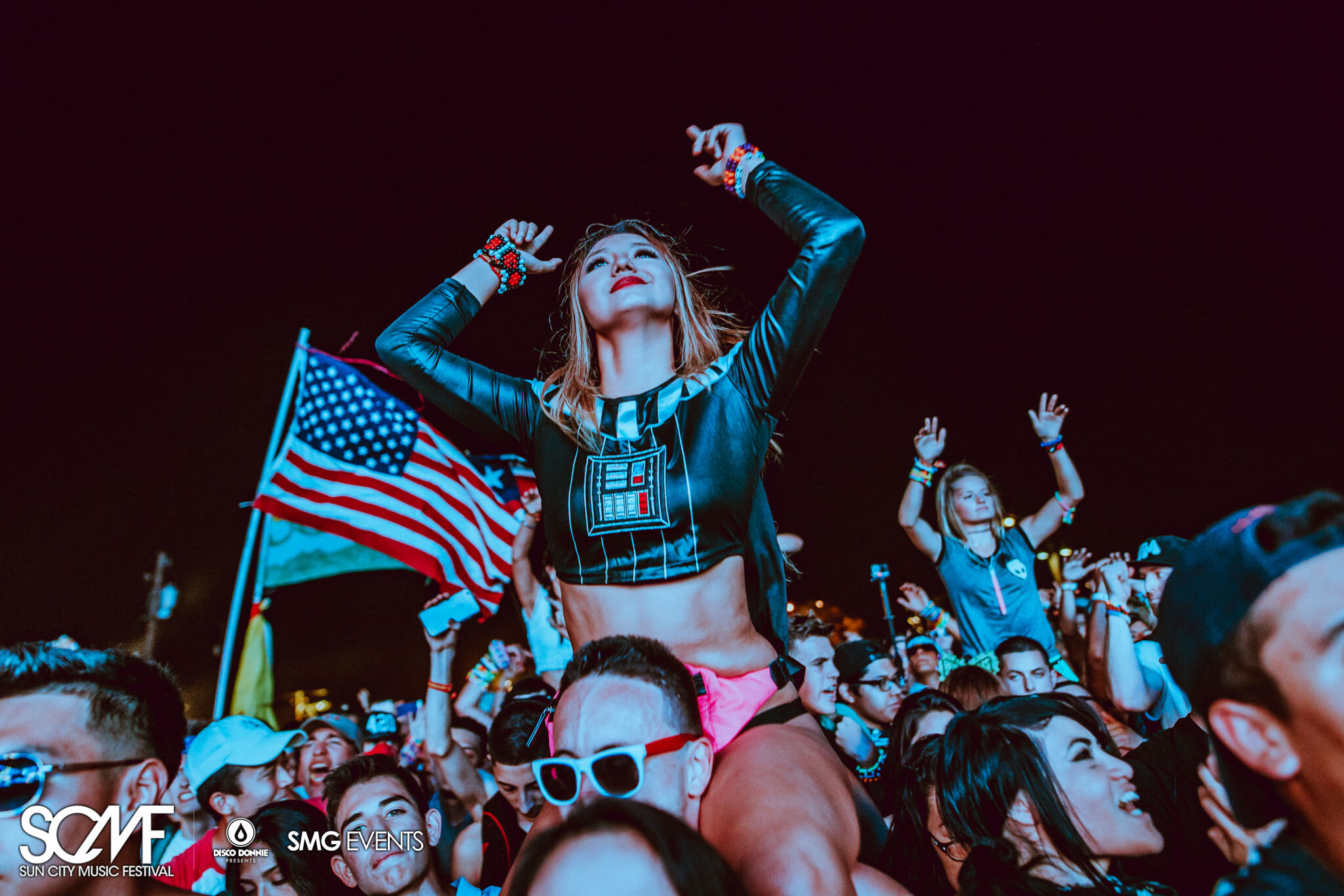girl on guys shoulder with american flag