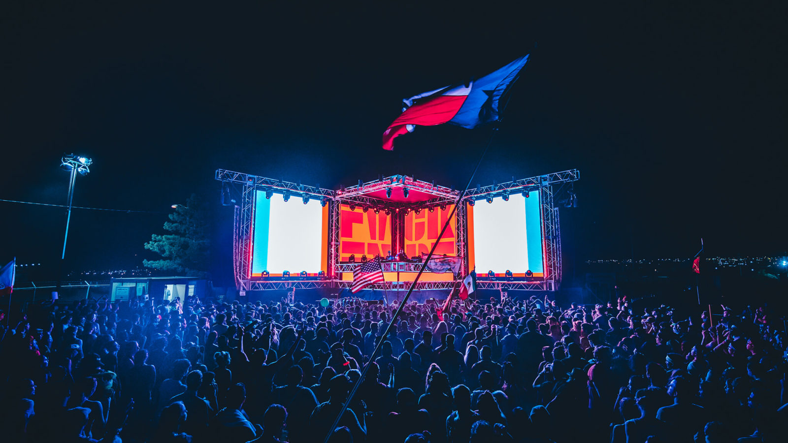 stage with flag in lights
