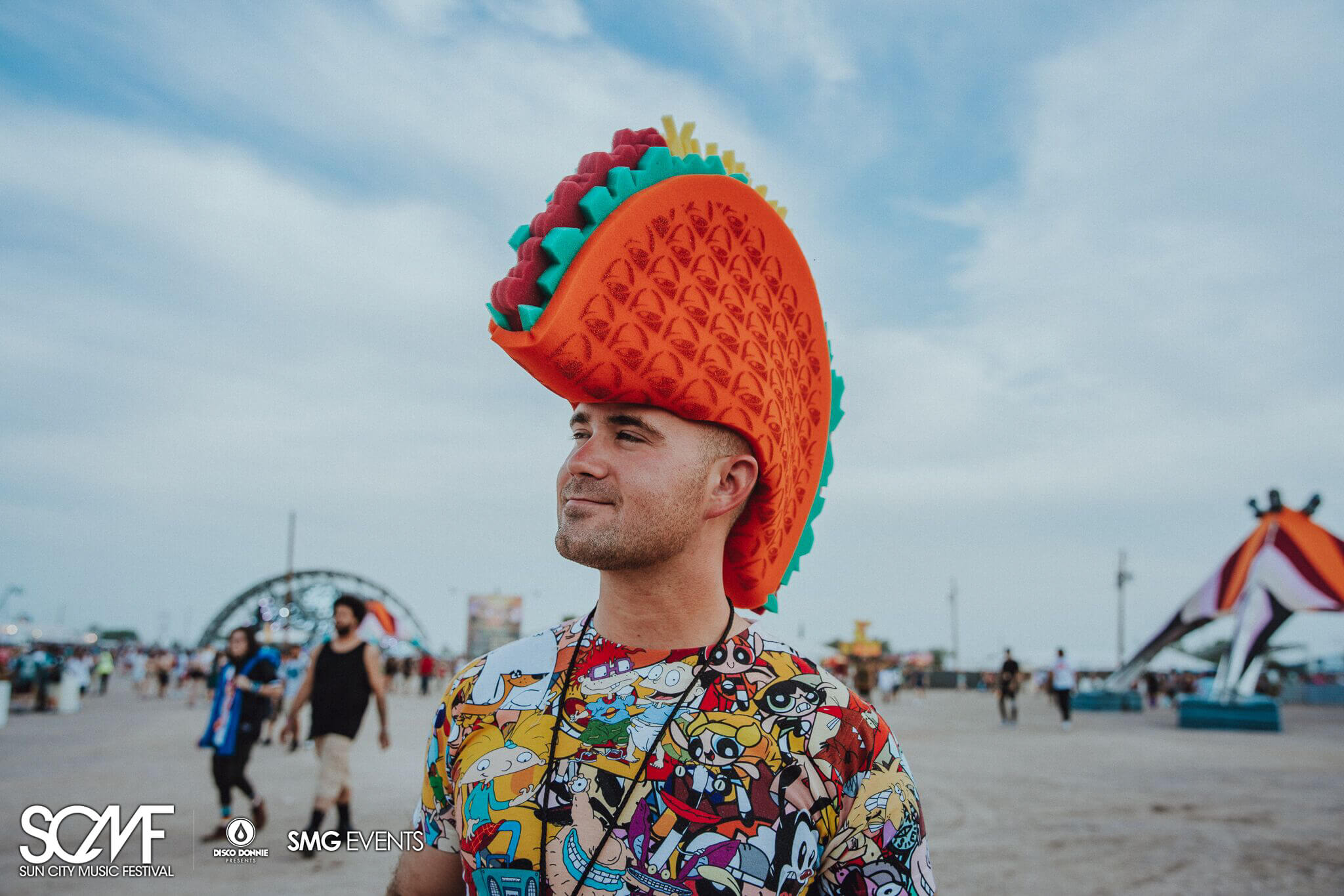 festival fan wearing taco hat