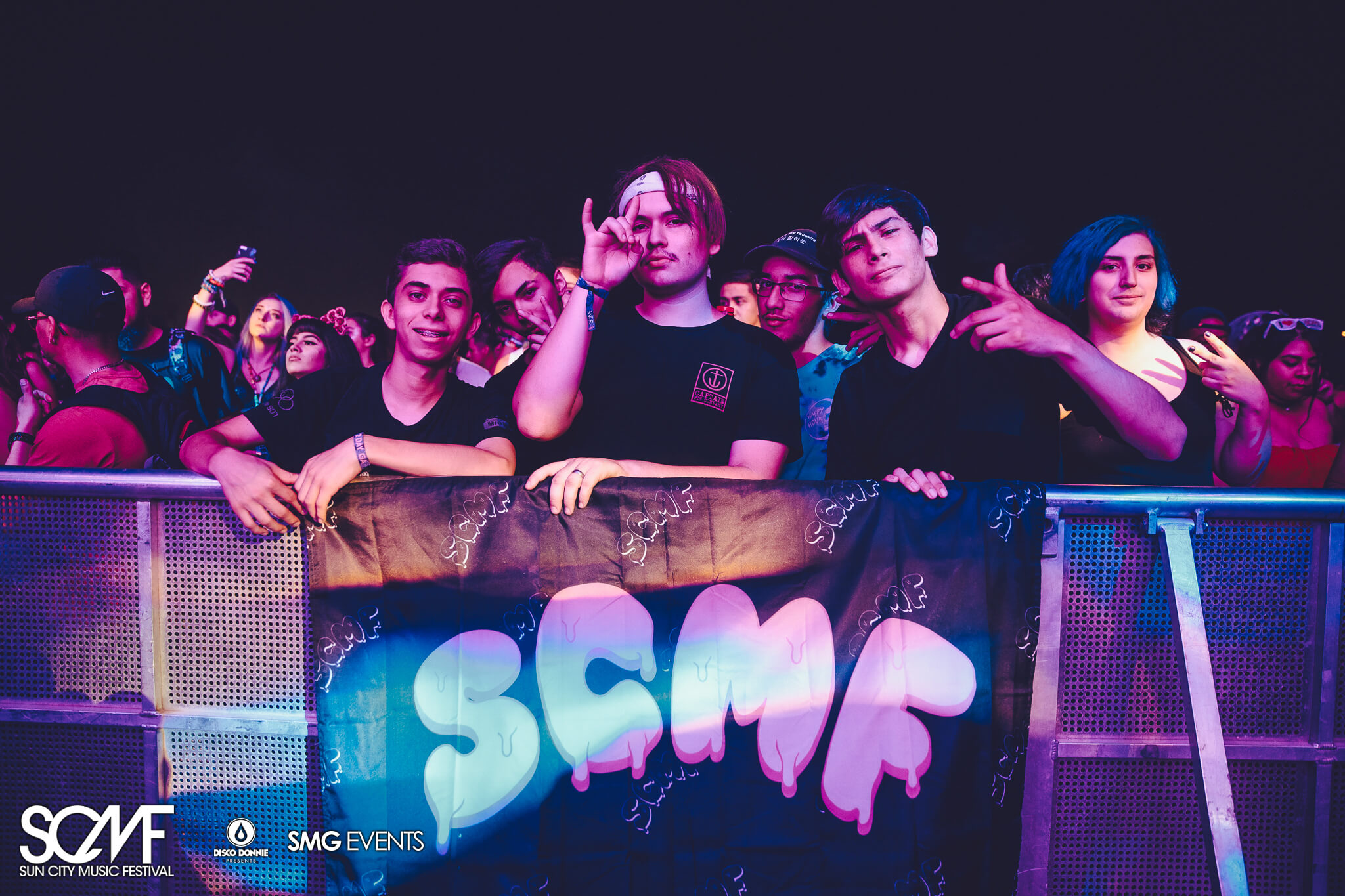 front row fans with scmf flag