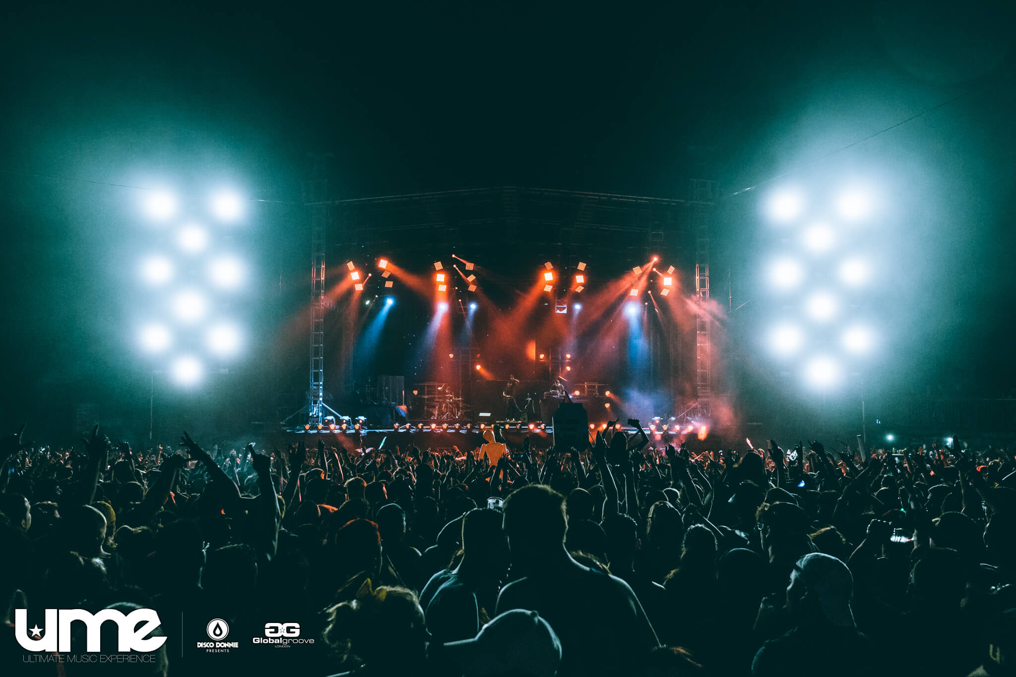 crowd and lights at ultimate music experience