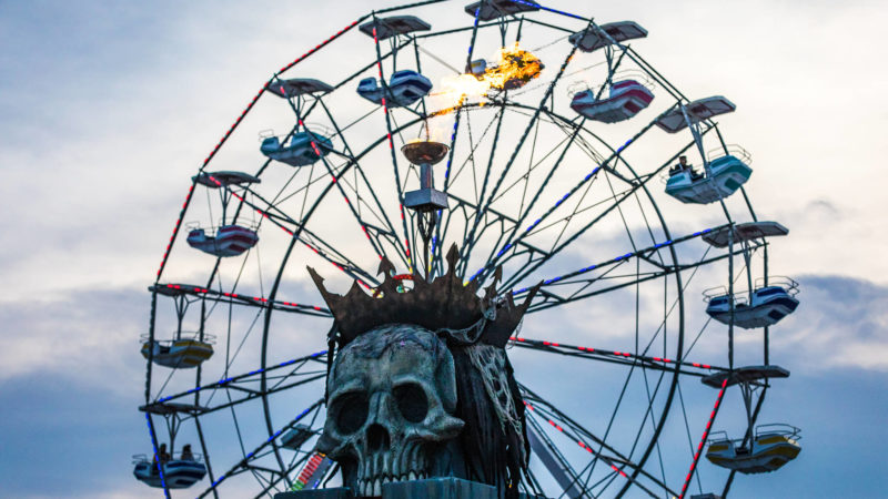 party goers ride the ferris wheel