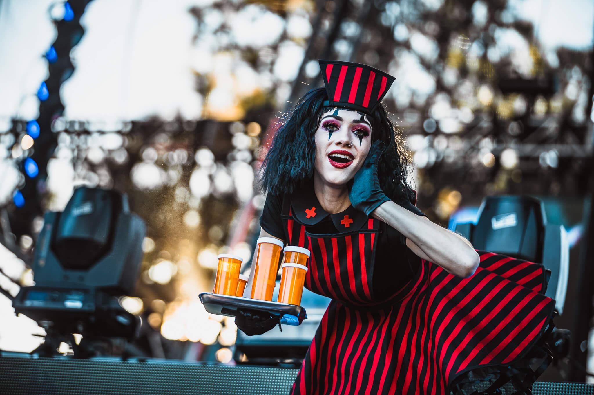 costumed performer serving up the medicine