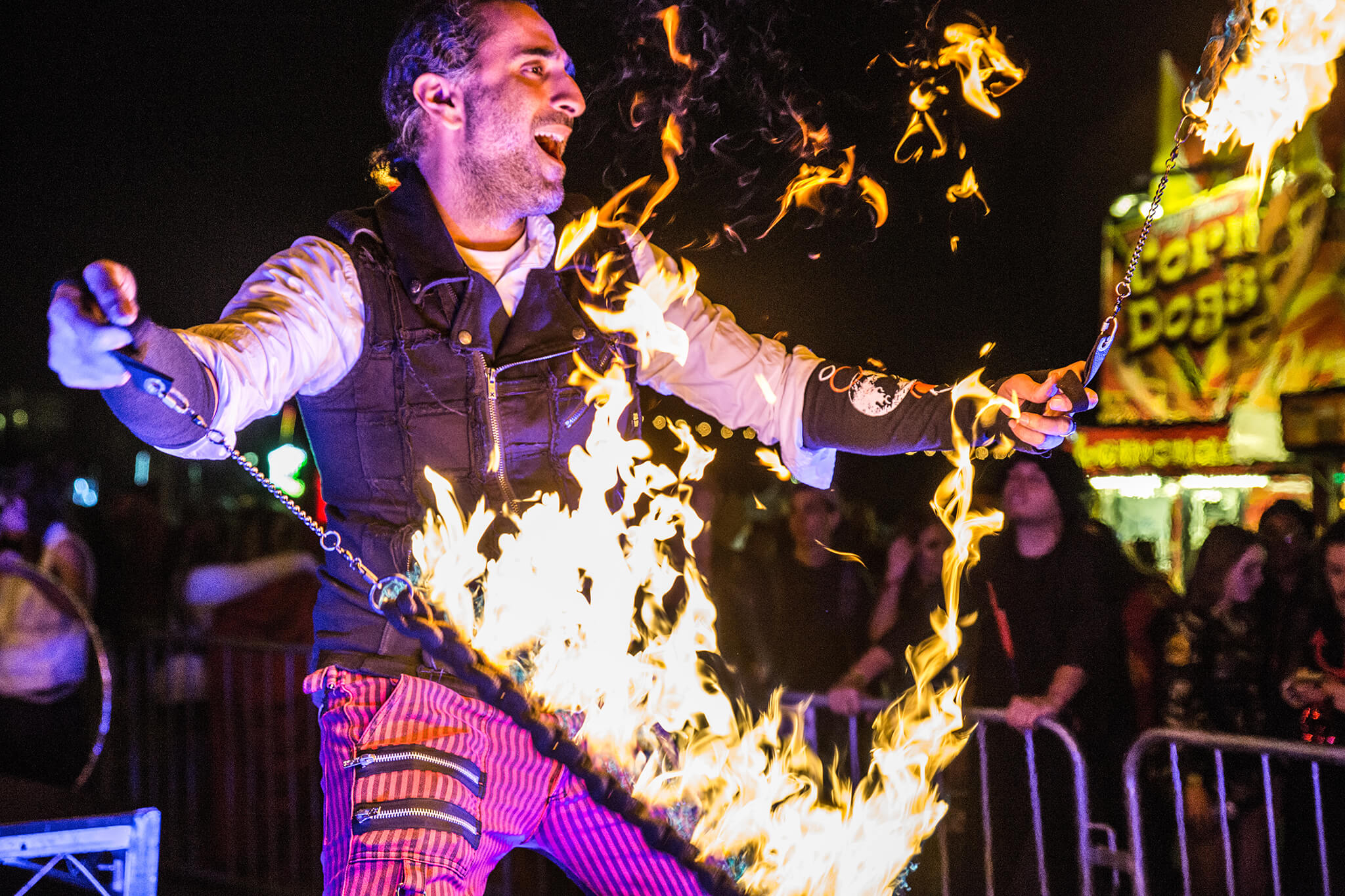 costumed performer getting fired up