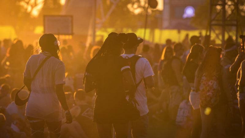 fans enjoying the festival at sunset