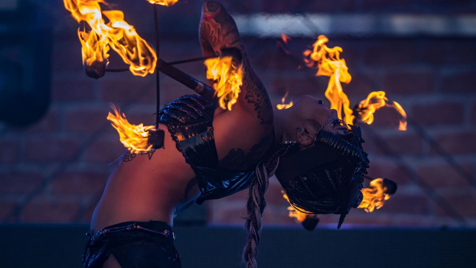 costumed performer working with fire