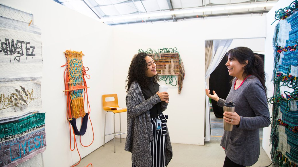 MFA Fine Arts students chatting during Open Studios, 2017_features_MB