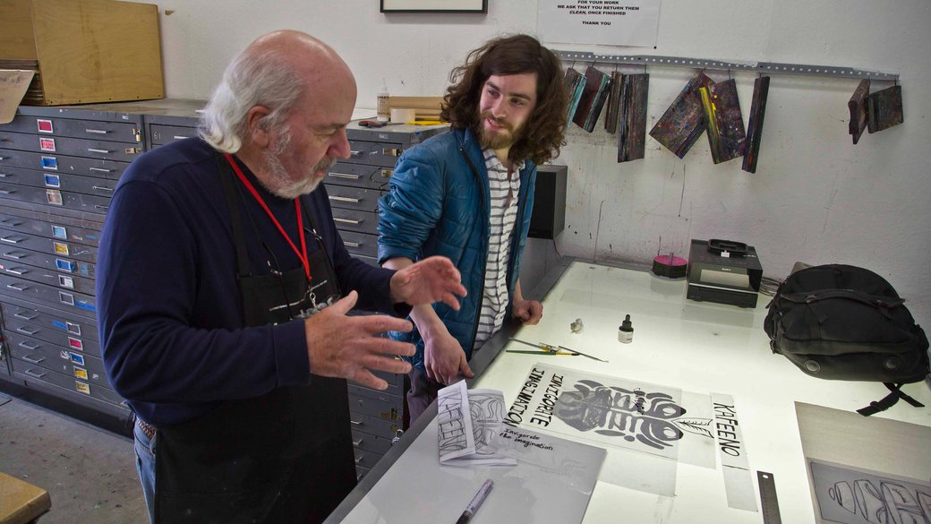 Screenprinting students getting one-on-one instruction from faculty_feature_MB