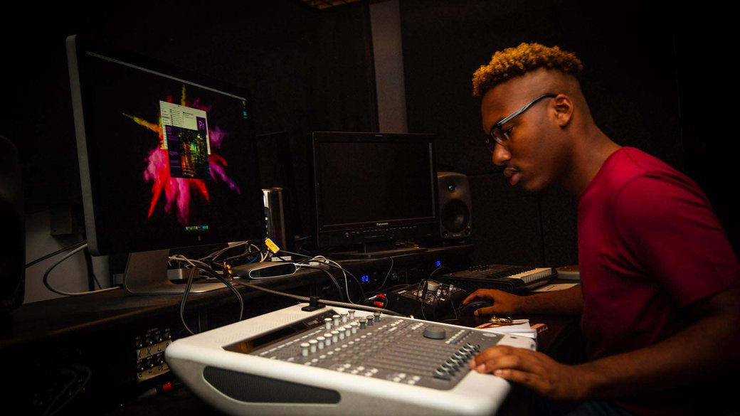 BFA Film student works on audio and sound correction in post-production film studio_Horizontal Feature_MB