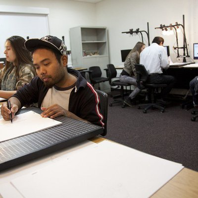 Student working on hand-drawn animation frames in the CCA Down-shooting Lab
