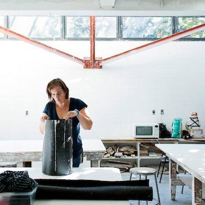 Student sculpting in CCA's Plaster Mold Studio