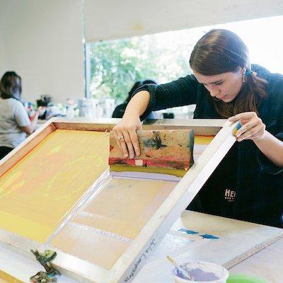 Student doing screenprinting in CCA's Hybrid Print Studio