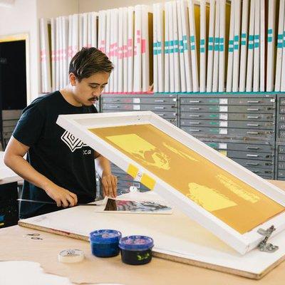 Printmaking student using silkscreens to make prints_horizontal feature_MB