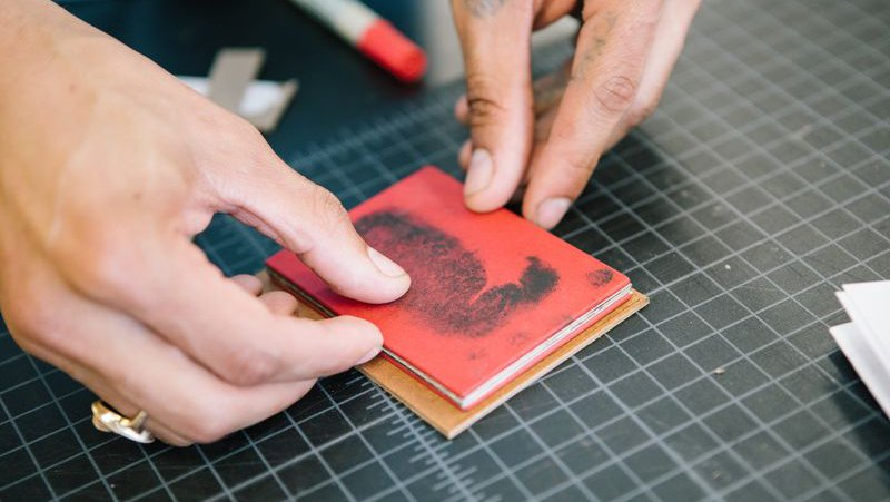 Student pressing prints in a book making class_horizontal feature_MB