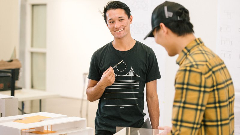 Architecture student smiling before their class crit_apply feature_MB