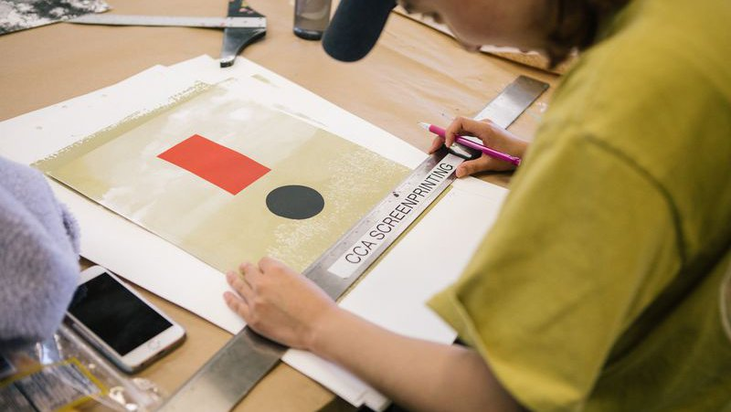 Printmaking student measures their design_horizontal feature_MB