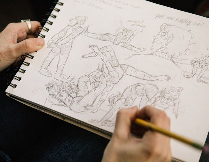 Student working on animation sketches during class