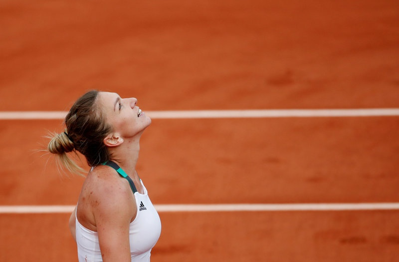 Romania's Simona Halep celebrates winning her semi final match against