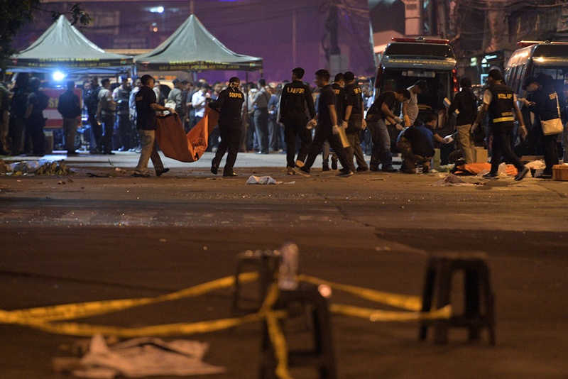 Police investigate the scene of an explosion at a bus station in Kampung Melayu East Jakarta Indonesia. Antara