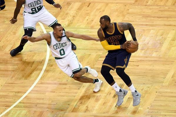 Boston MA USA Cleveland Cavaliers forward Le Bron James looks to pass around Boston Celtics guard Avery Bradley dur