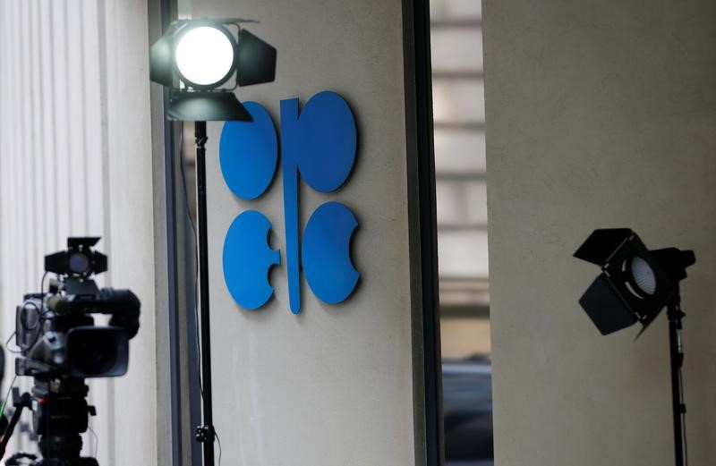 Oil prices settle lower on disappointment in OPEC's production policy