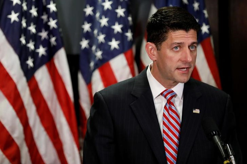 Ryan pitches tax reform at shoe factory as protesters gather