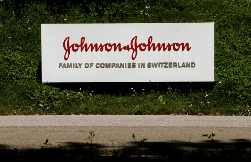 The logo of healthcare company Johnson & Johnson is seen in front of an office building in Zug Switzerland