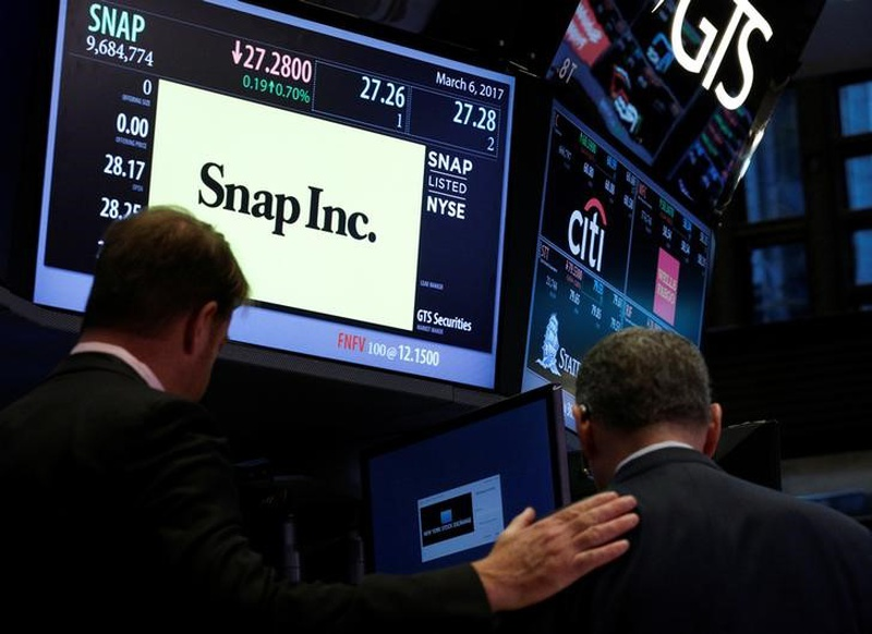 Traders gather at the post where Snap Inc. is traded on the floor of the New York Stock Exchange in New York U.S