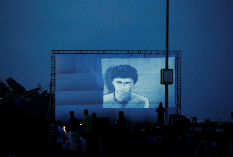 A film is screened during the third edition of the Red Carpet Film Festival at the seaport of Gaza City