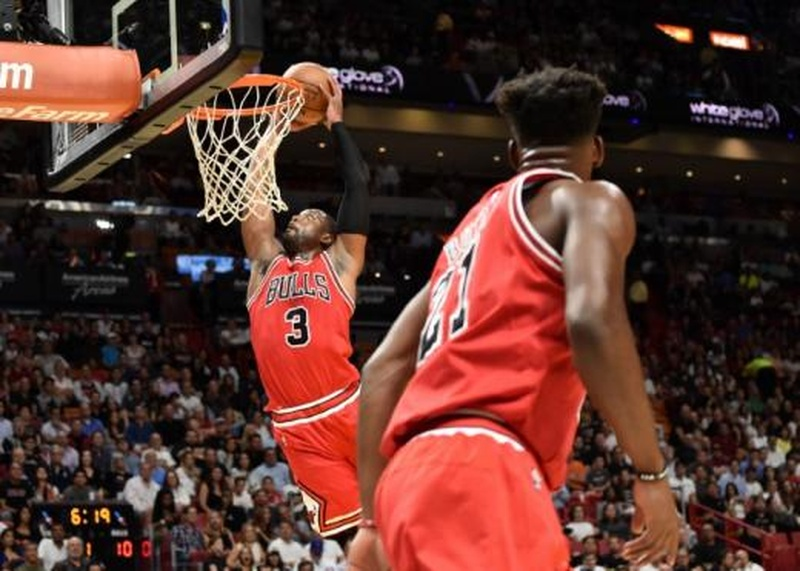 Nov 10 2016 Miami FL USA Chicago Bulls guard Dwyane Wade dunks the ball as Bulls forward Jimmy Butler looks on against... Steve Mitchell