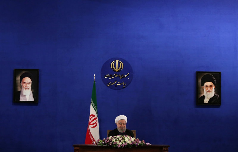 Brooding Iran hardliners say they must still be heard after Rouhani win