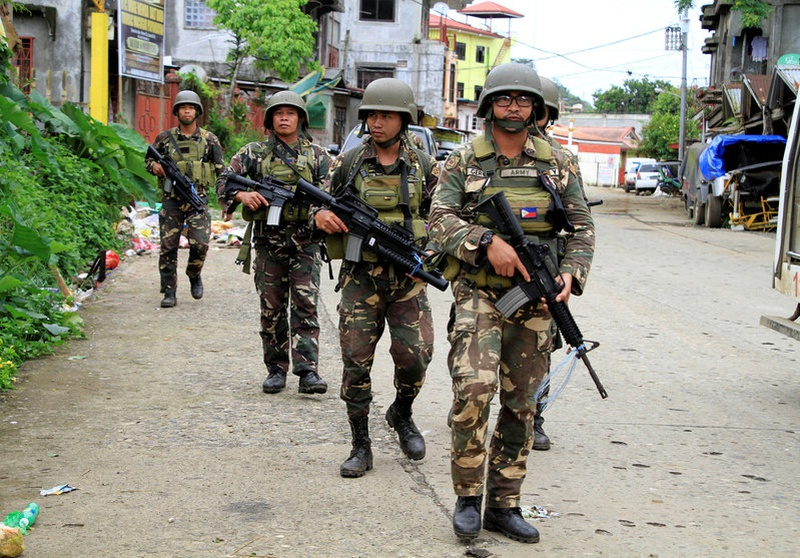 Philippines says may break Islamist militants' city siege soon