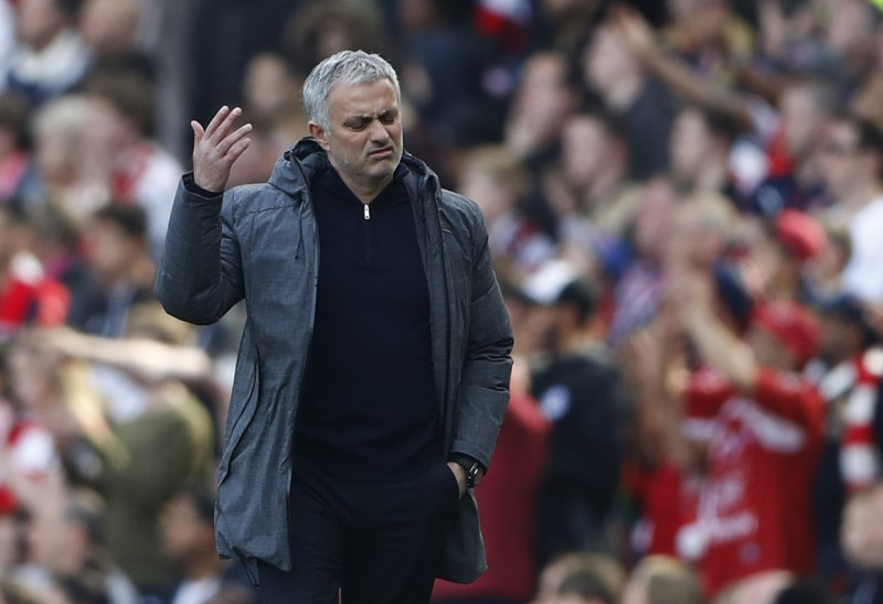 Mourinho takes digs at Wenger after first defeat