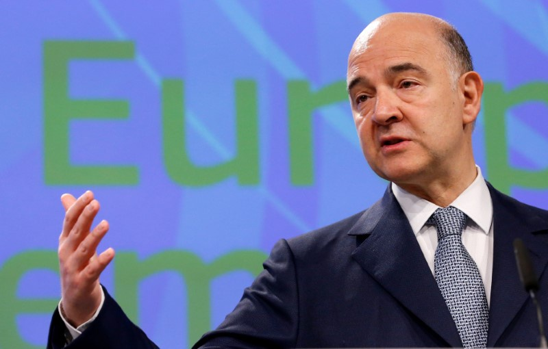 European Economic and Financial Affairs Commissioner Pierre Moscovici addresses a news conference at the EU Commission headquarters in Bruss