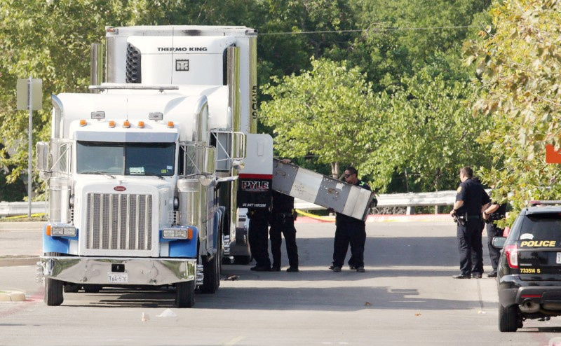 Eight people found dead in tractor trailer in Texas parking lot